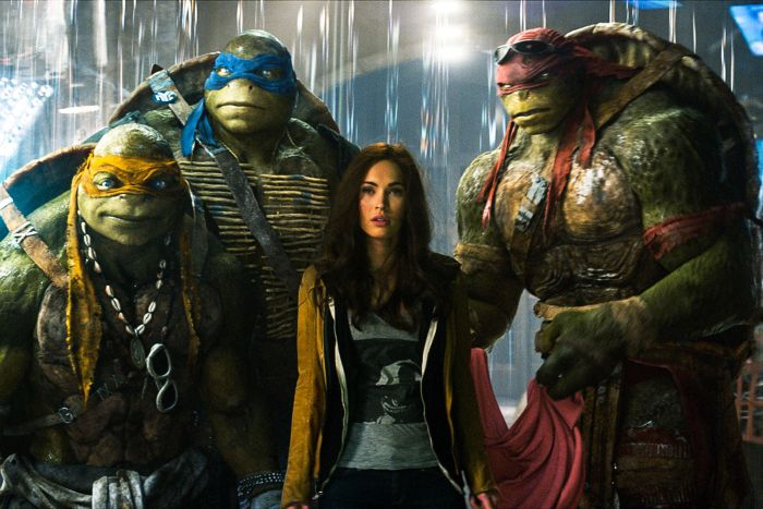 """This image released by Paramount Pictures shows, from left, Michelangelo, Leonardo, Megan Fox, as April O'Neil, Raphael, and Donatello in a scene from """"Teenage Mutant Ninja Turtles."""" (AP Photo/Paramount Pictures, Industrial Light & Magic)"""